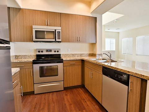 Unfurnished kitchen model with stove and microwave