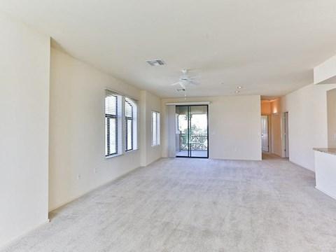 Unfurnished carpeted living room model