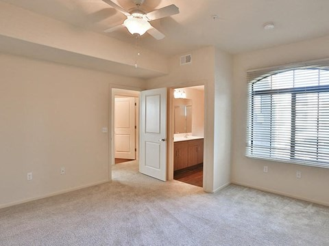 Unfurnished carpeted living room with ceiling fan
