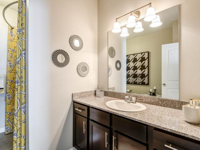 Designer Granite Countertops in all Bathrooms at Adeline at White Oak, Garner