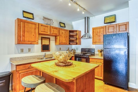 Fitted Kitchen With Island Dining at CityView Apartments, North Carolina, 27406
