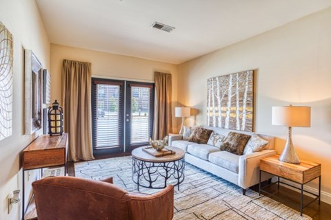 Living Room With Expansive Window at CityView Apartments, Greensboro, NC, 27406
