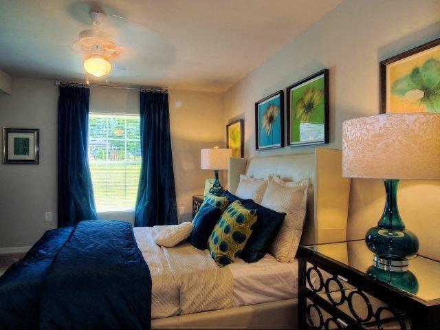 Trendy Bedroom Interior at Innisbrook Village Apartments, Greensboro, NC, 27405