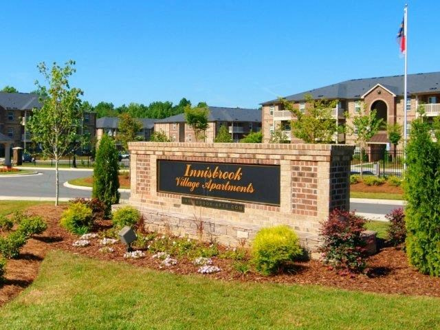 Grand Entrance Sign at Innisbrook Village Apartments, Greensboro, NC, 27405