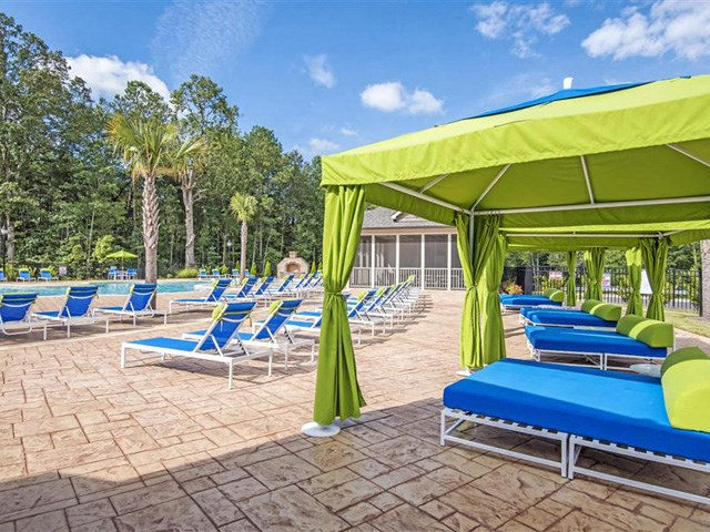 Shaded Lounge Area by Pool at Bacarra Apartments, North Carolina