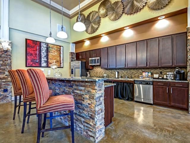 Demonstrative Kitchen with Breakfast Bar at Village at Town Center, Raleigh