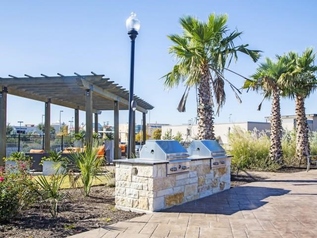 Shaded Lounge Area with Poolside Gas Grill at Arrington Ridge, Round Rock, TX