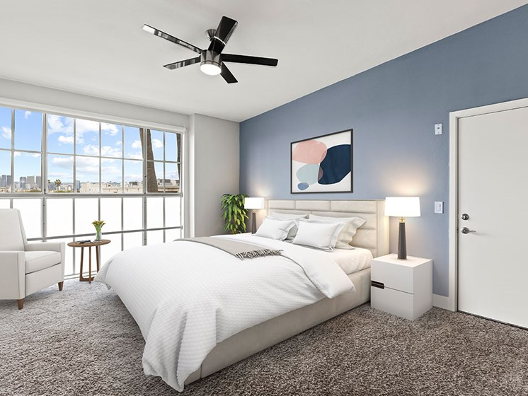 Bedroom with gorgeous window view and ceiling fan.