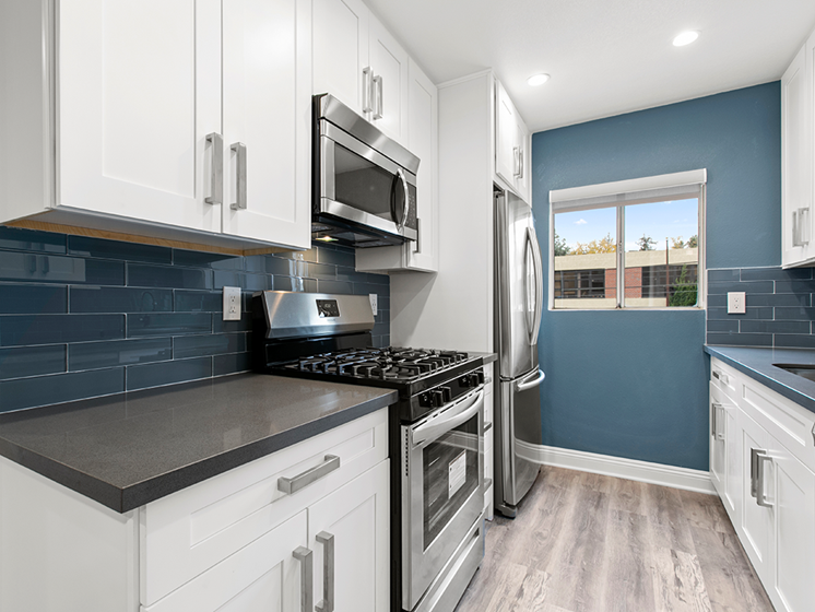 Kitchen featuring Stainless Steel Oven and Range.
