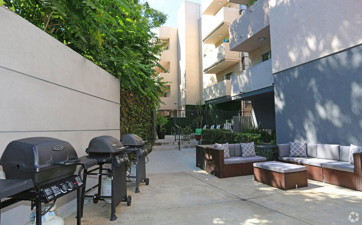 Courtyard view of community seating area next to barbecues