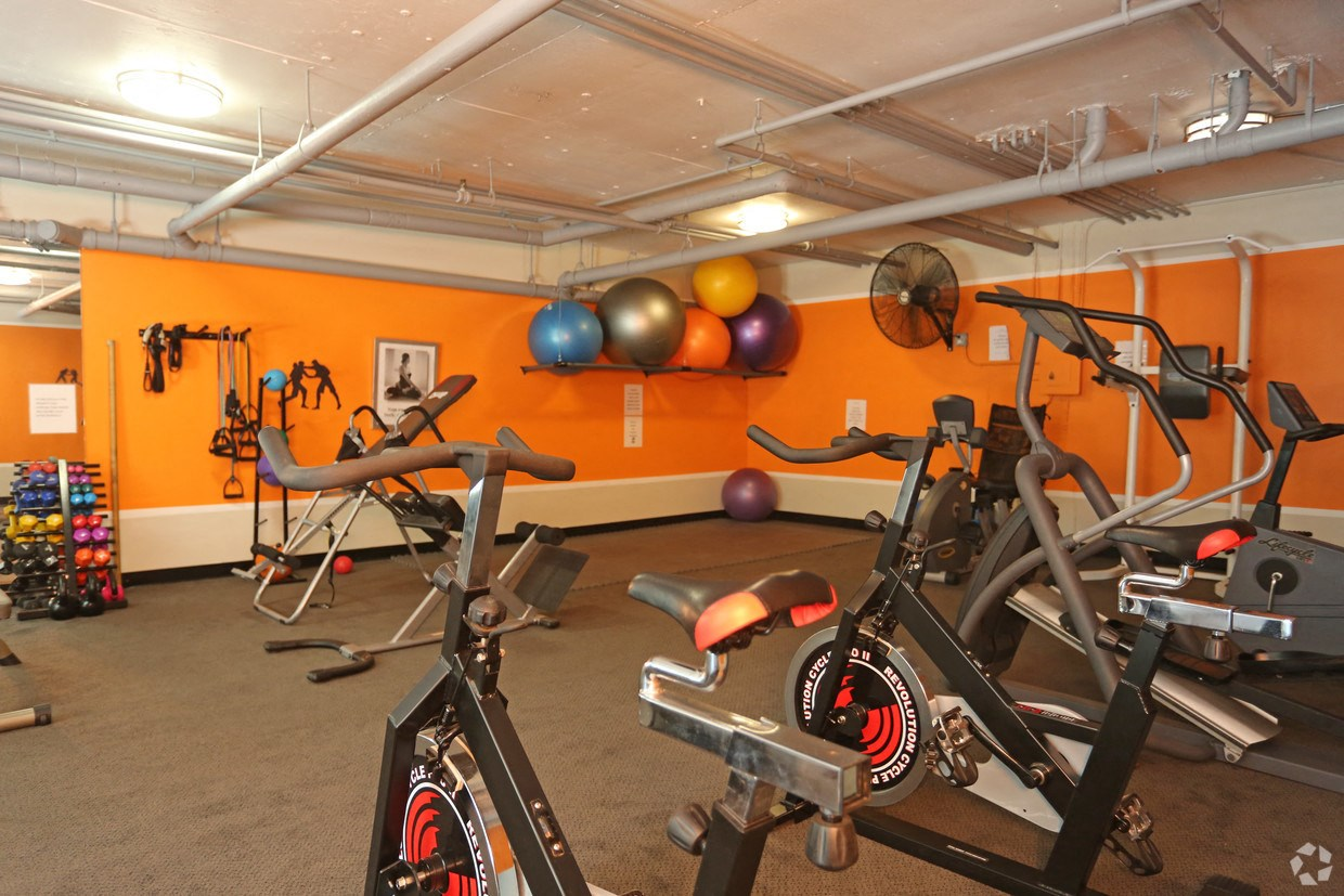 View of the Fitness Center Including Jump Ropes, Cycling Bikes, Ellipticals, Free Weights and Stretching Balls