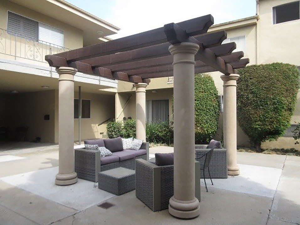 Shaded courtyard gazebo for relaxing or reading.