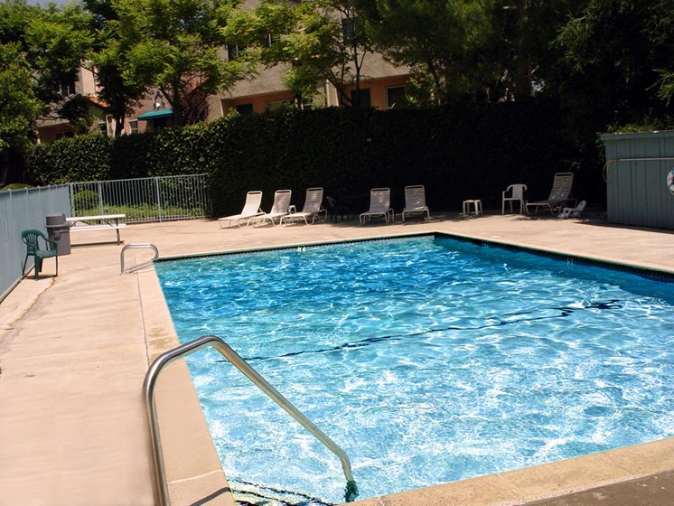 Beautiful community pool with lounging area.