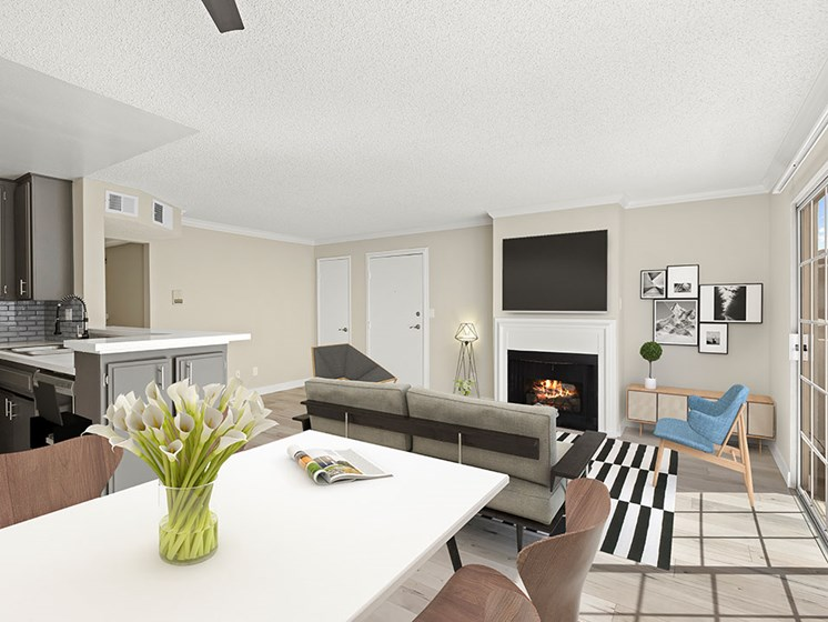 Living room with hardwood floor and view of dining room and kitchen area.