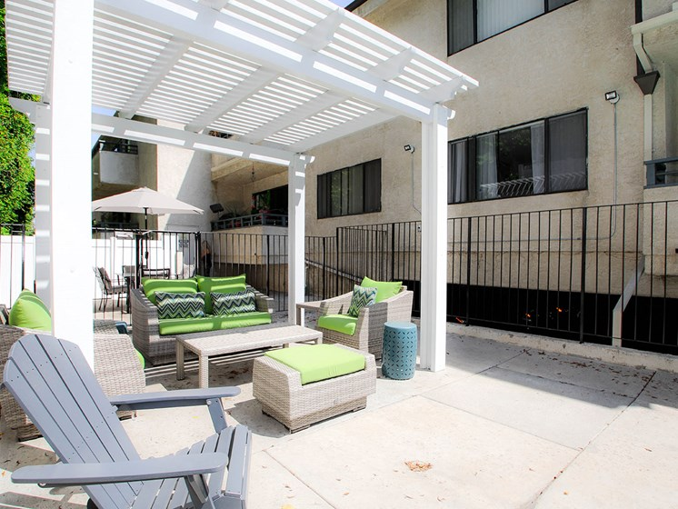 Community barbecue area with seating and lounging space.