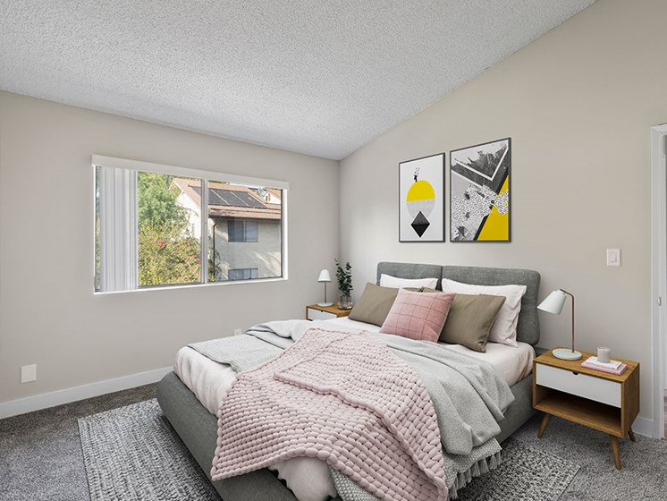 Carpeted bedroom with natural light windows.