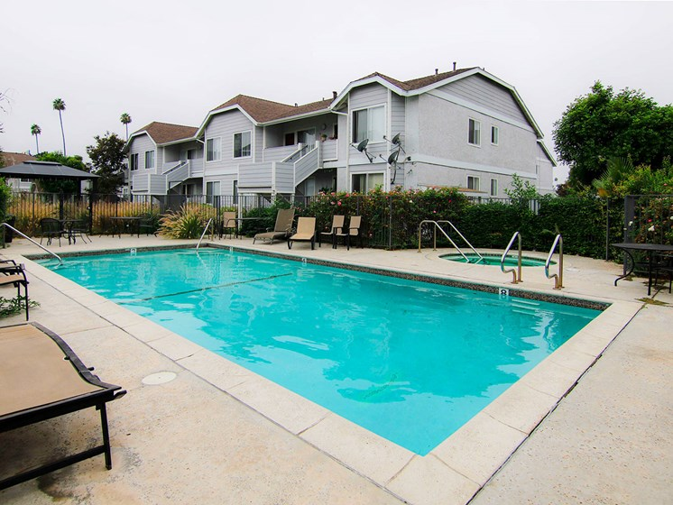 Large courtyard swimming pool, including jacuzzi and lounging area.