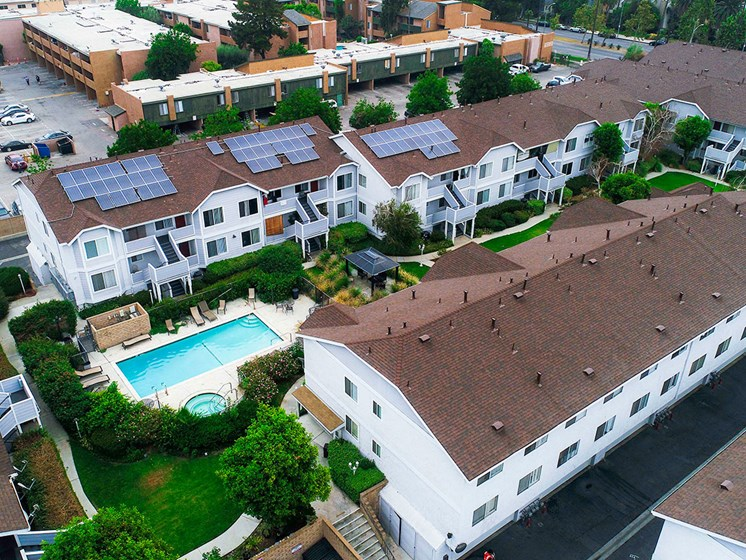 Aerial drone view of roof showcasing solar panels for a low carbon footprint.