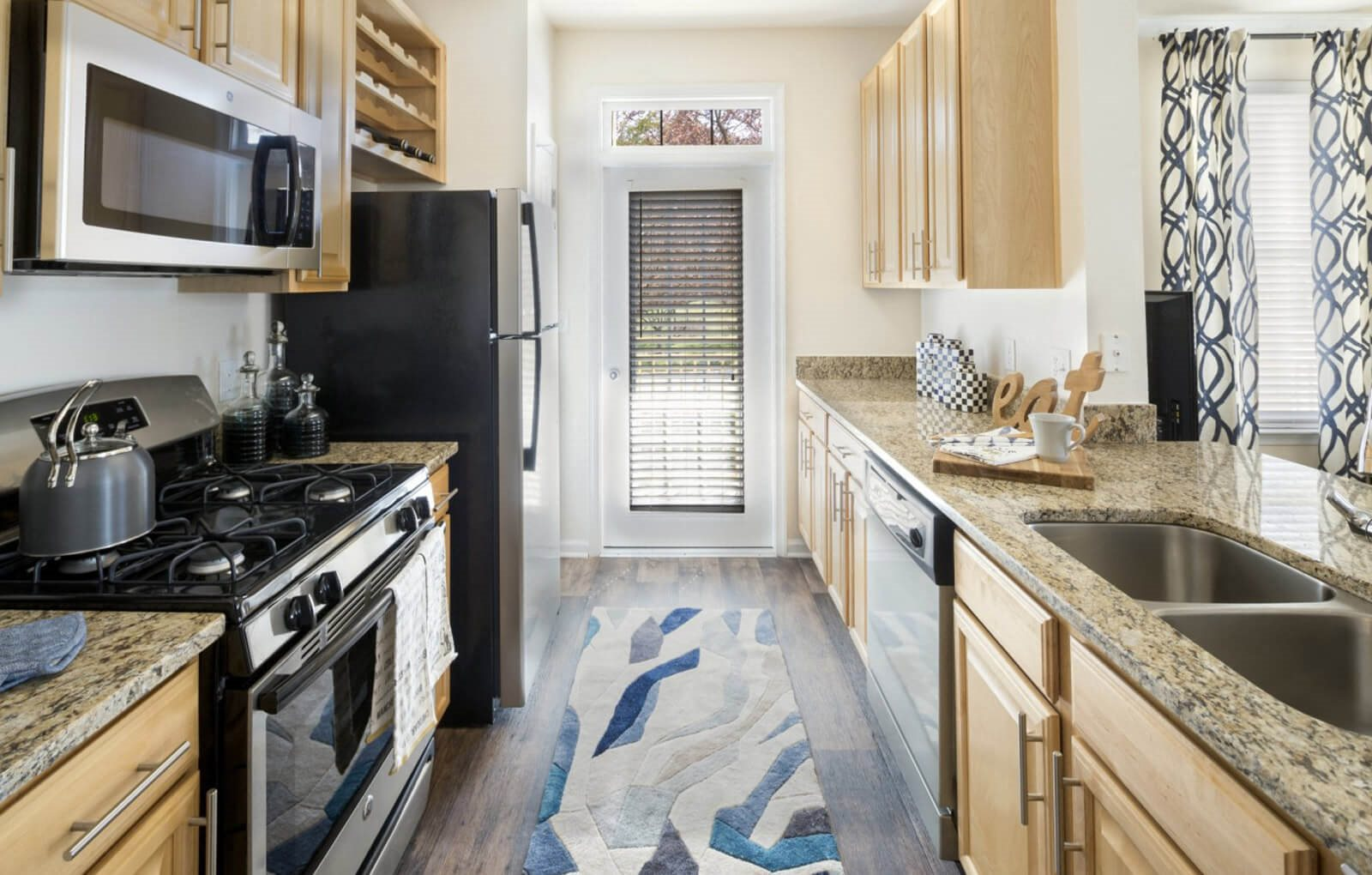 Beautifully upgraded kitchens with stainless steel appliances at Westwind Farms Apartments in Ashburn, VA
