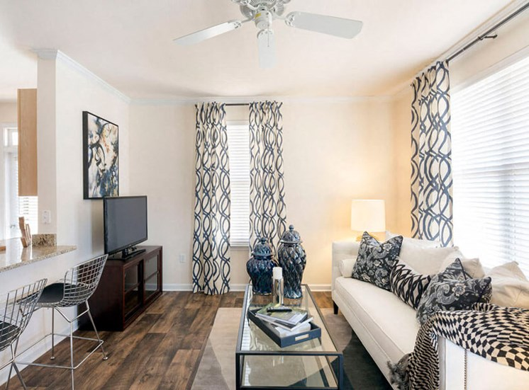 Living Room with wood-look flooring at Westwind Farms Apartments