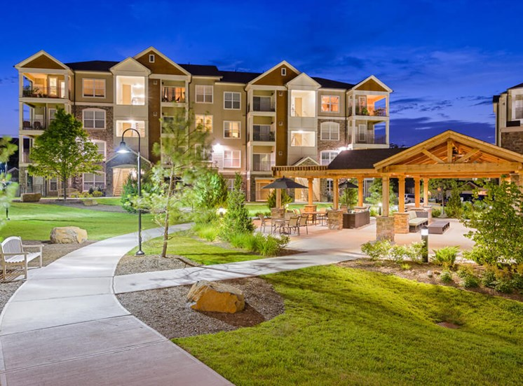 landscaped paved trails at Atley on the Greenway Apartments in Ashburn, VA