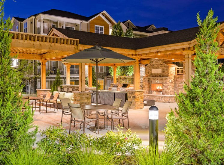 Covered outdoor dining spaces at Atley on the Greenway Apartments in Ashburn, VA