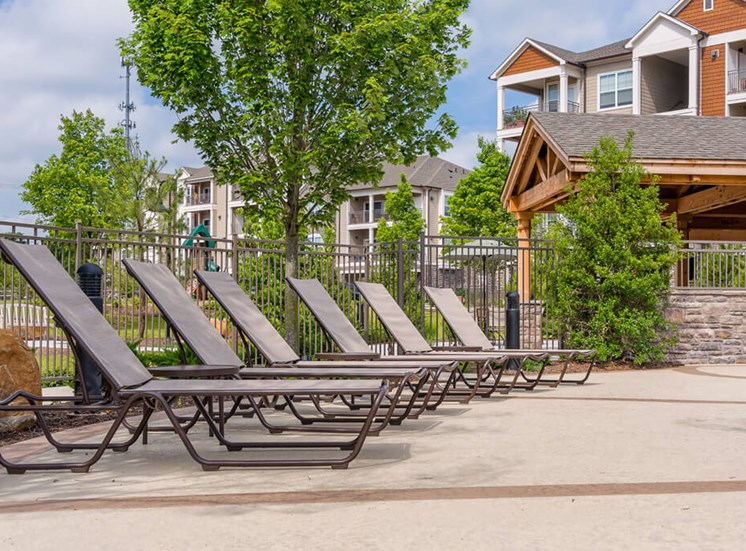 Pool lounge chairs at Atley on the Greenway Apartments in Ashburn, VA