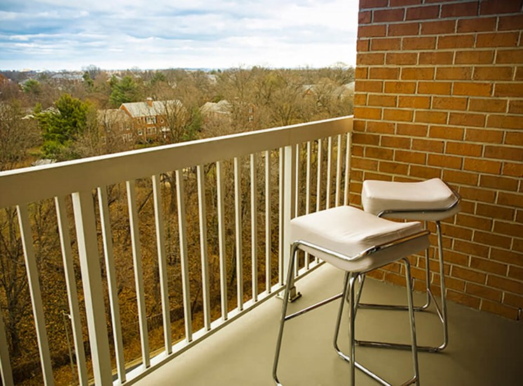 Relax on your spacious patio at The Alexander Apartments in Alexandria, VA