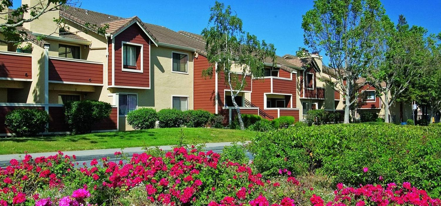 Landscaped exterior at Belmont Apartment Homes in Pittsburg, CA