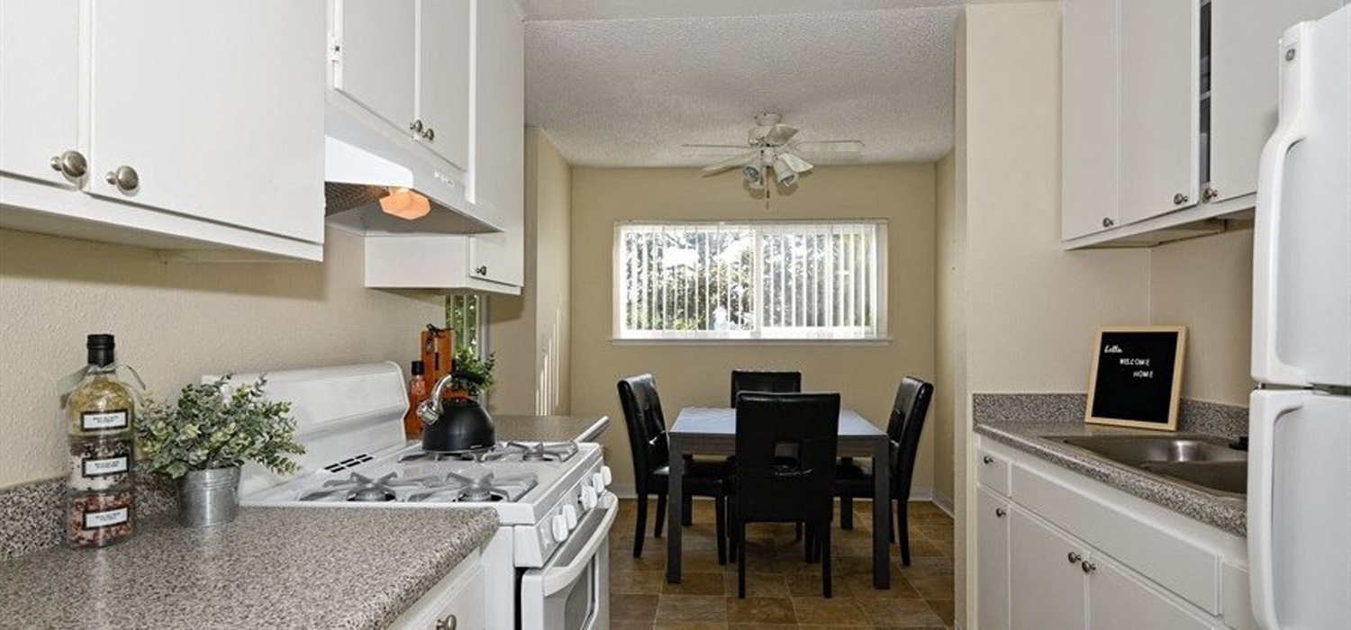 white kitchen cabinets  at Canyon Rim Apartments in San Diego, CA