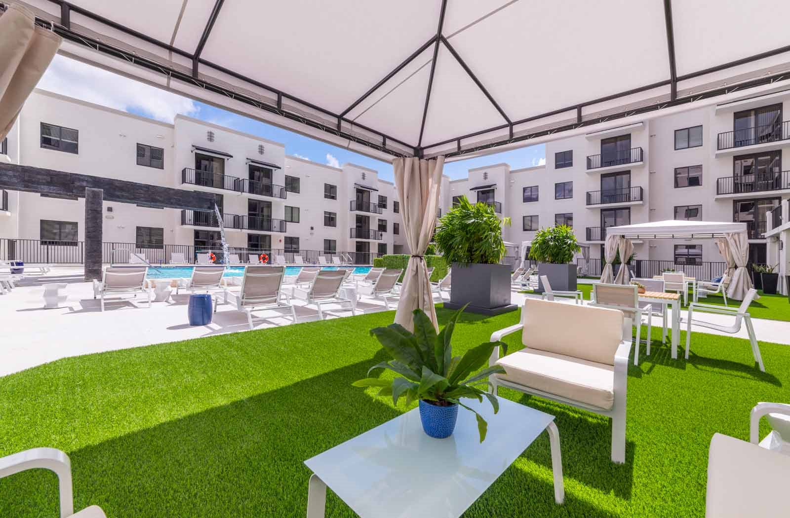 outside private cabana | District West Gables Apartments in West Miami, Florida