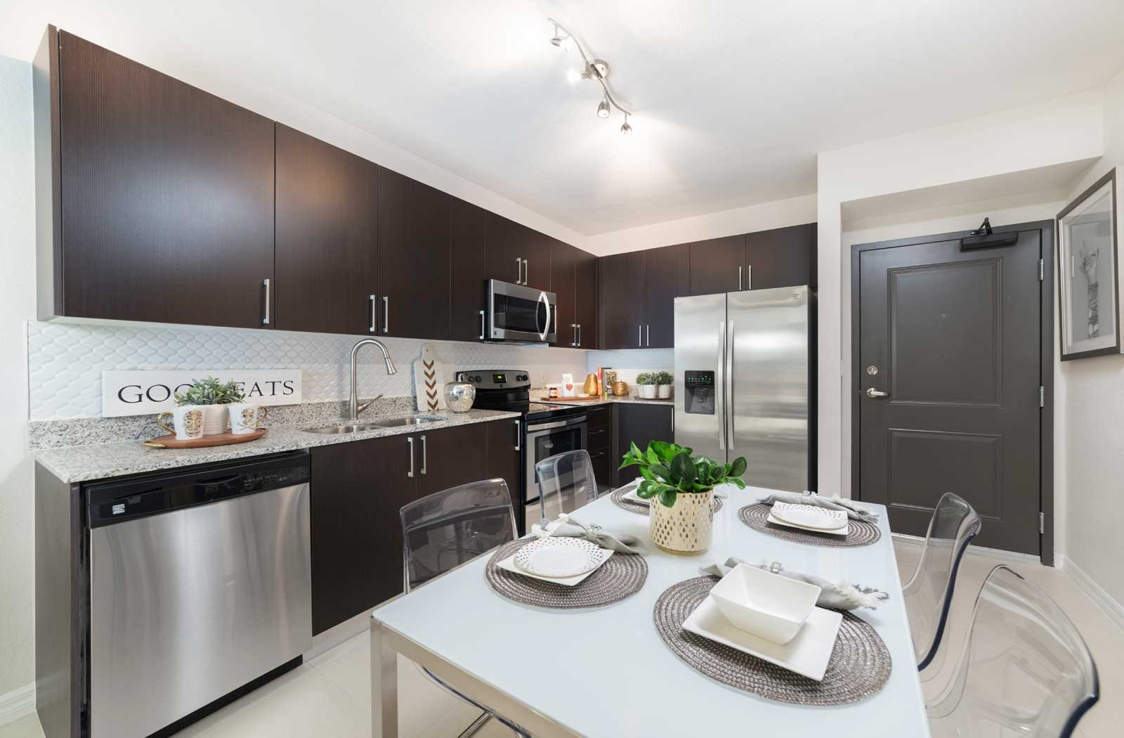 gourmet kitchen with granite countertops| District West Gables Apartments in West Miami, Florida