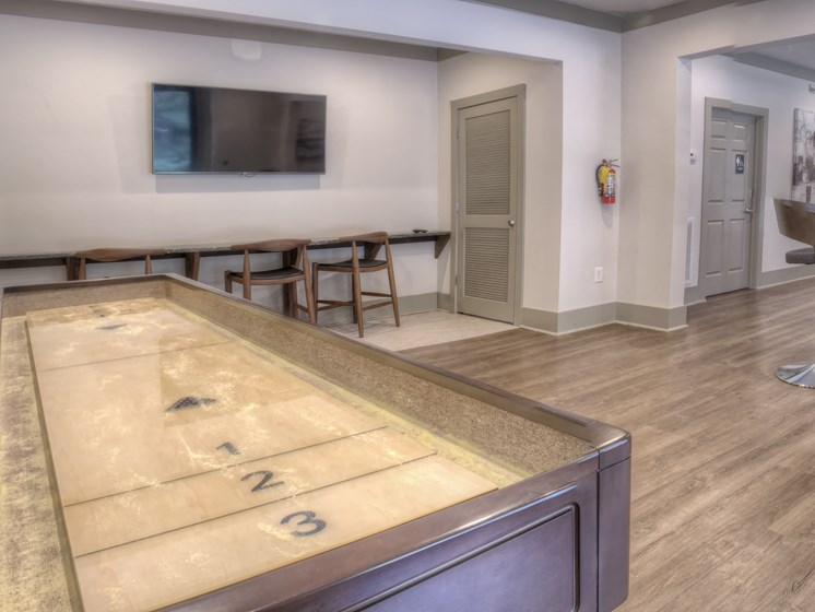 Luxury Apartments in Roswell | Wesley St. James Apartments | Resident Clubhouse with Shuffleboard