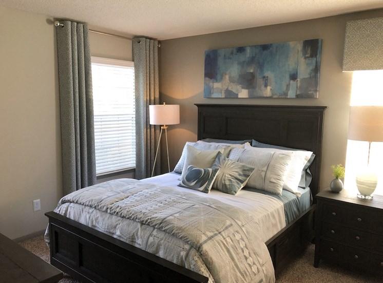 Spacious bedroom & plush carpet at Viera Aiken Apartments