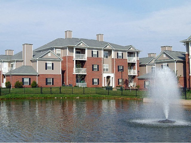 Building exterior overlooking pond at The Belvedere Apartments in Richmond, VA