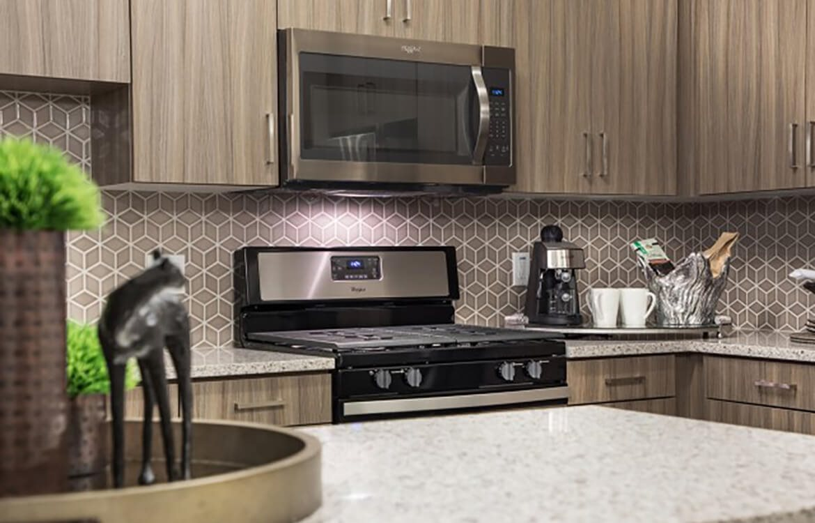 Stainless steel kitchen appliances at Areum Apartments in Monrovia CA
