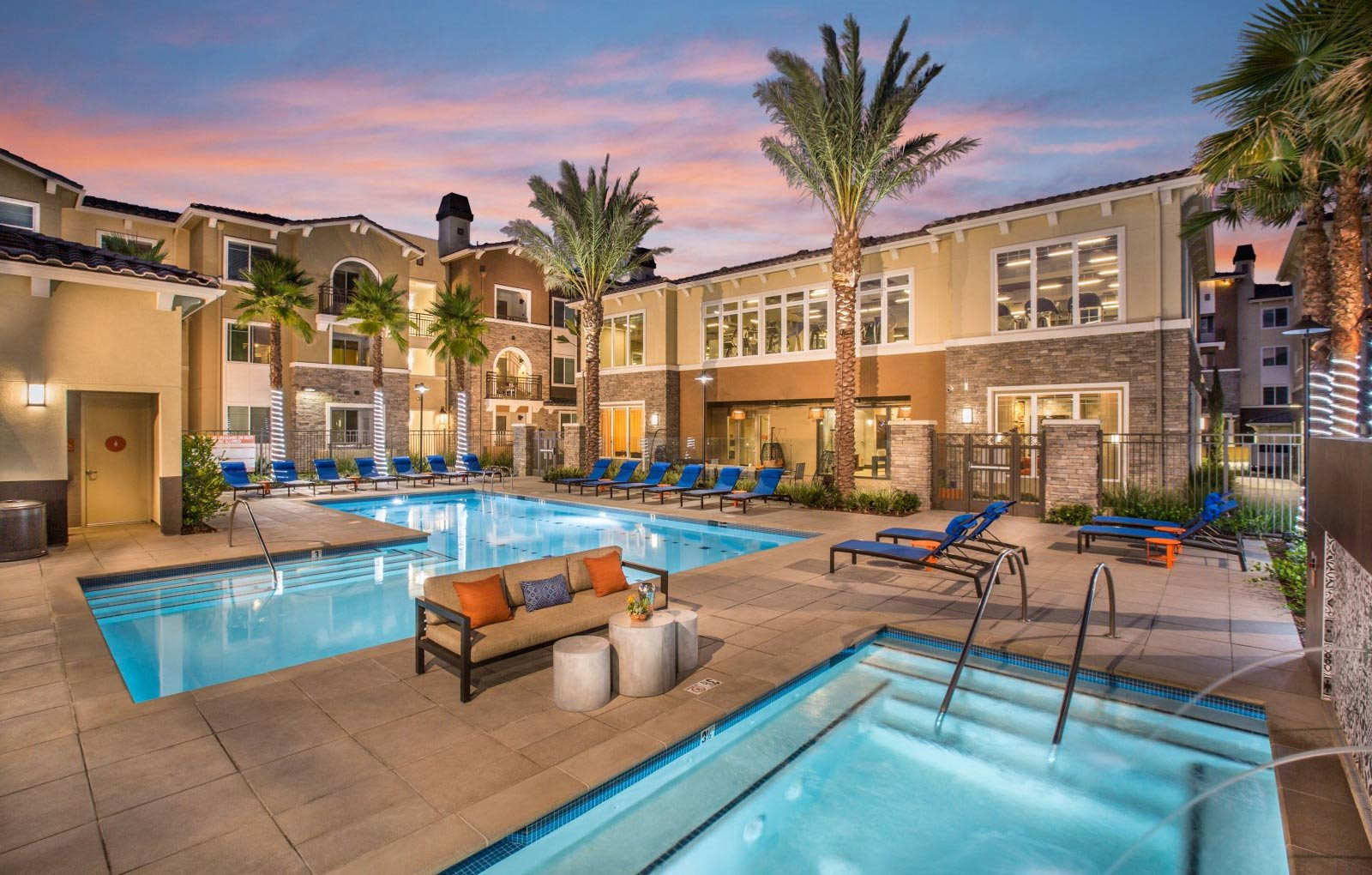 pool and spa with resort style cabanas at Valentia Apartments in La Habra, CA