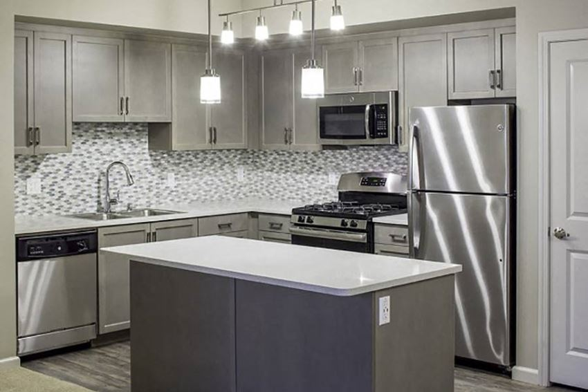 Chef caliber kitchens with stainless steel appliances at Valentia Apartments in La Habra, CA