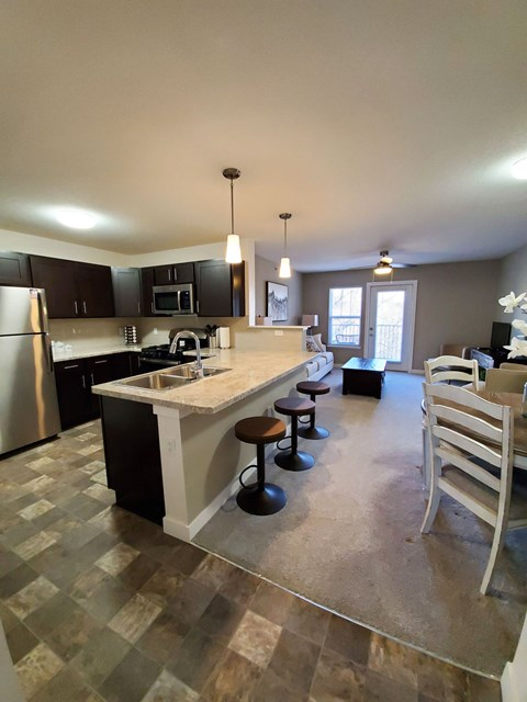 Modern Kitchen with Stainless Steel Appliances at Strathmore Apartment Homes, West Des Moines, Iowa