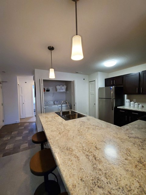 Chef Inspired Kitchen with Chic Pendant Lighting at Strathmore Apartment Homes, West Des Moines, IA, 50266
