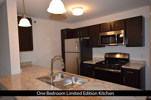 Fully equipped kitchen with stainless steel appliances at Strathmore Apartment Homes, West Des Moines, 50266