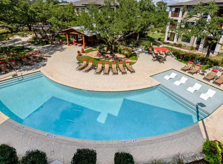 Outdoor resortinspired pool with lounge chairs