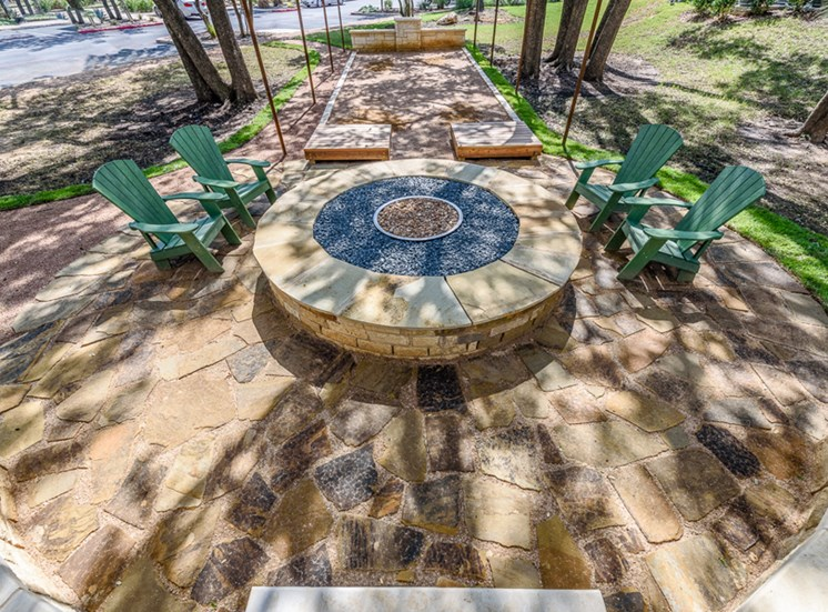 Outdoor firepit and game areawith lounge seating area
