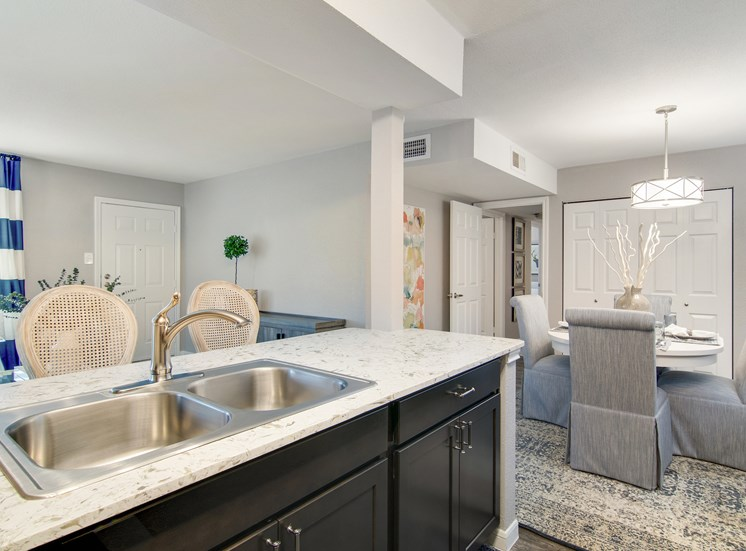 Kitchen With View of Dining Room at The Village at Bunker Hill in Houston, Texas
