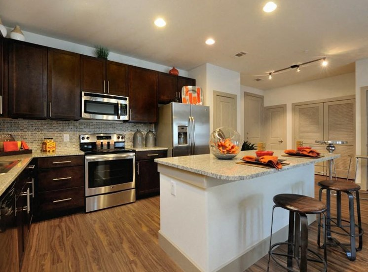 Kitchen with Over-the-Range Microwaves at Broadstone Park West Apartments, Houston, 77084