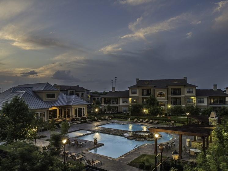 Pool View at Dusk at Palm Valley Apartments, Round Rock, Texas