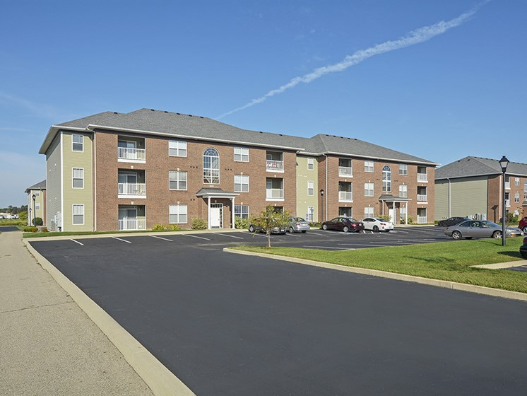 Exterior of a Towne Park Apartment Building with Parking