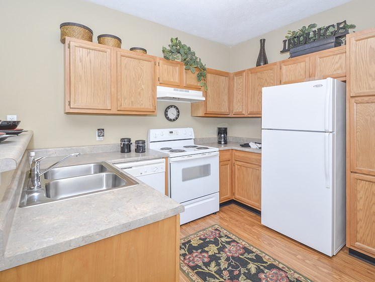 Spacious Kitchen with Oak Cabinets and White Appliances