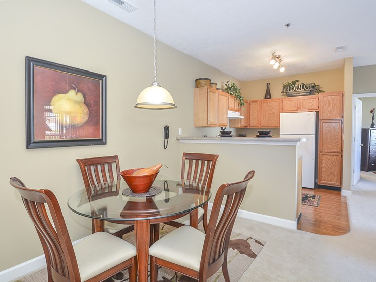 Open Concept Kitchen and Carpeted Dining Room with Overhead Light