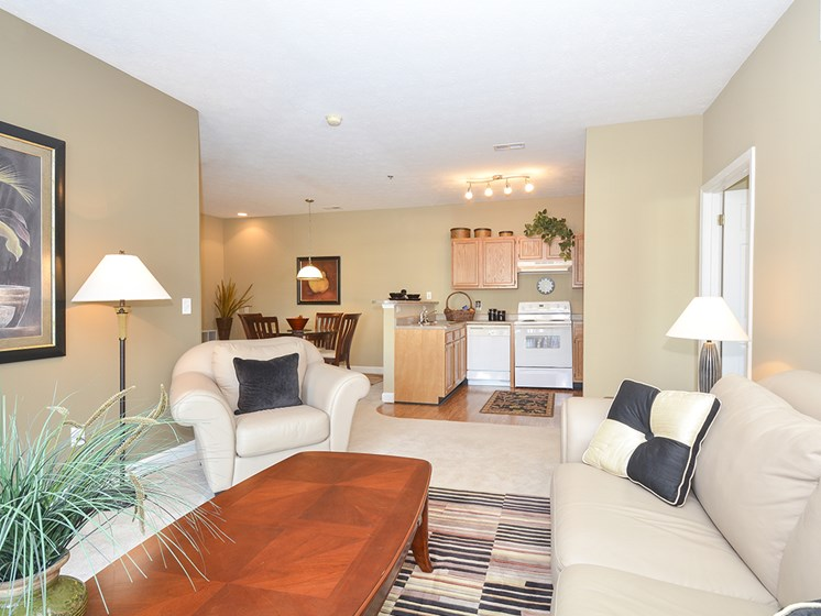 Spacious Carpeted Living Room with Beige Walls
